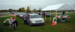 Outdoor scene with cars pulling through to receive flu shots