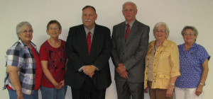 Pictures of five board members and the administrator