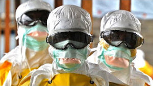 Health Care Workers in full protective gear